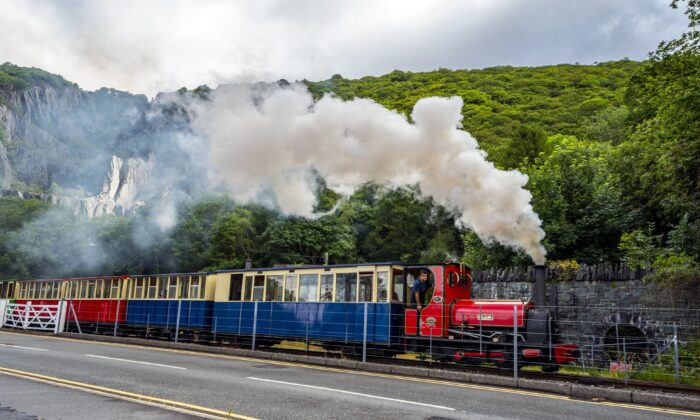 A steam train runs past the north-west Wales slate landscape, in Wales, on July 28, 2021. (Peter Byrne/PA)