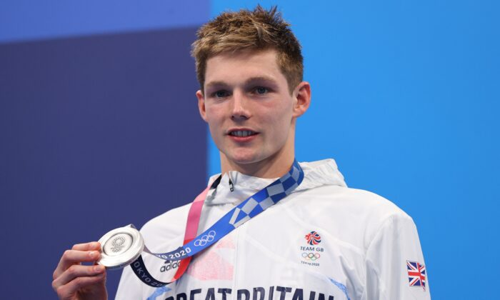 Duncan Scott of Britain poses on the podium with the silver medal of Men's 200-metre Individual Medley, at Tokyo 2020 Olympics, Tokyo, Japan, on July 30, 2021. (Marko Djurica/Reuters)