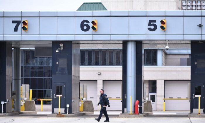 A Canadian Border Services Agency worker is seen at the Canada/USA border crossing in Windsor, Ont. on March 21, 2020. (The Canadian Press/Rob Gurdebeke)
