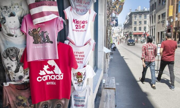 People walk by a souvenir store in Old Montreal, on May 24, 2021. (The Canadian Press/Graham Hughes)