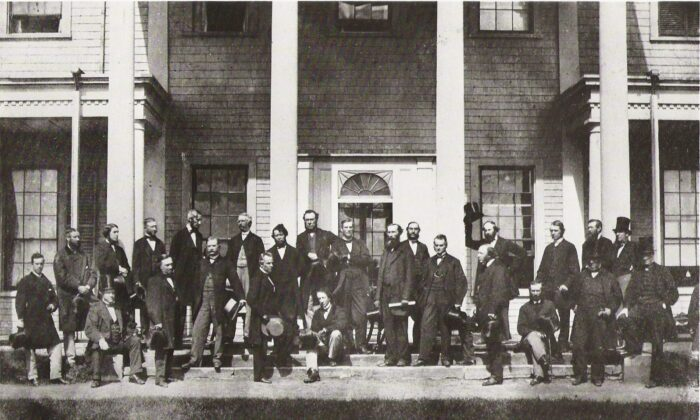 The Fathers of Confederation at the Charlottetown Conference in September 1864, where they gathered to consider the union of the British North American Colonies. Sir John A. Macdonald is seated in the foreground, and standing on his right is Sir George-Étienne Cartier. (Public domain)