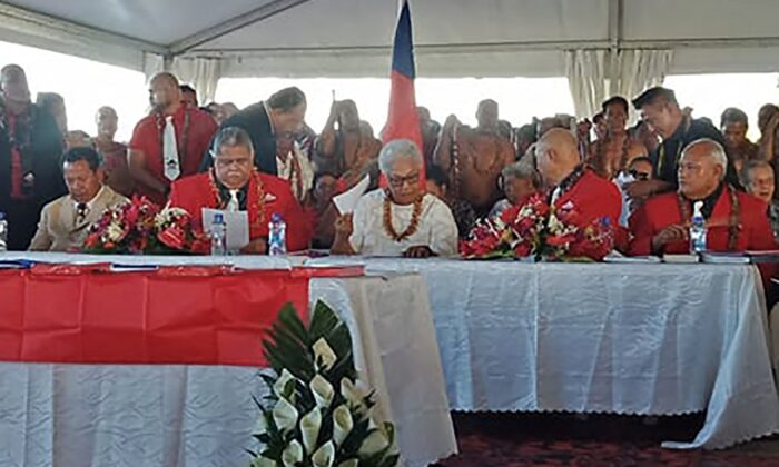Fiame Naomi Mata'afa (seated C-in white) sits with members of parliament and the judiciary as she is sworn in as Samoa's first female prime minister in Apia on May 24, 2021. (Malietoa/AFP via Getty Images)