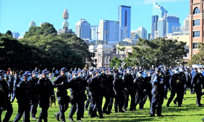 Police block the way to the marching protesters during an anti-lockdown rally in Sydney, Australia on July 24, 2021. (Steven Saphore/AFP via Getty Images)