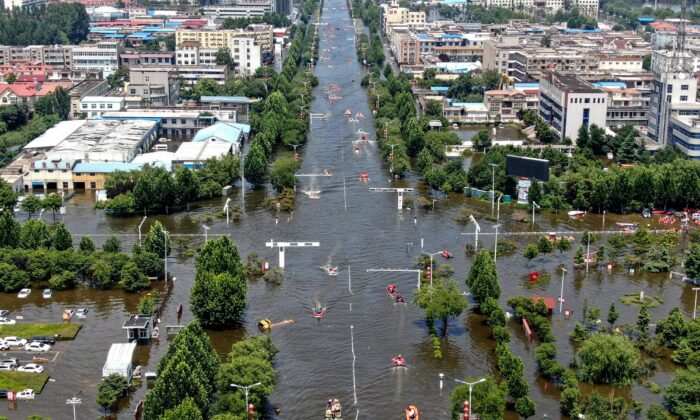 This aerial photo taken on July 26, 2021 shows a flooded area in the city of Weihui in China's central Henan Province. (STR/AFP via Getty Images)
