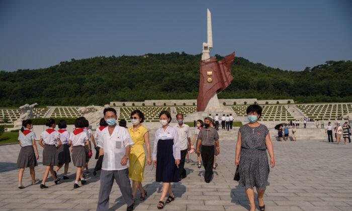 People walk at the Fatherland Liberation War Martyrs Cemetery as part of events marking the occasion of the 68th anniversary of the end of the Korean War in Pyongyang on July 27, 2021.  (Kim Won Jin/AFP via Getty Images)