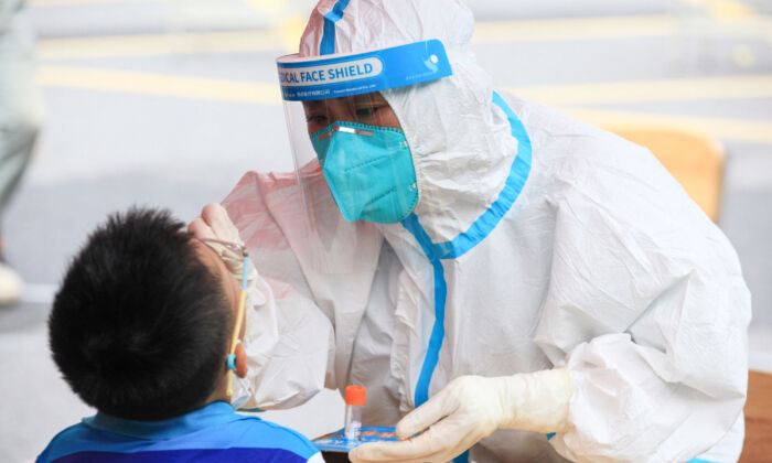A child receives a nucleic acid test for the Covid-19 coronavirus in Nanjing, in eastern Jiangsu province on July 29, 2021.(STR/AFP via Getty Images)