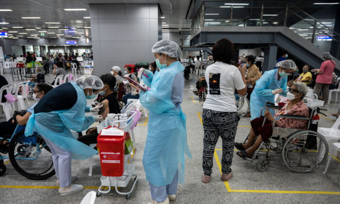 Health workers administer the AstraZeneca COVID-19 vaccines to the elderly at Central Vaccination Center in Bang Sue Grand Station in Bangkok, Thailand, on July 13, 2021. (Sirachai Arunrugstichai/Getty Images)
