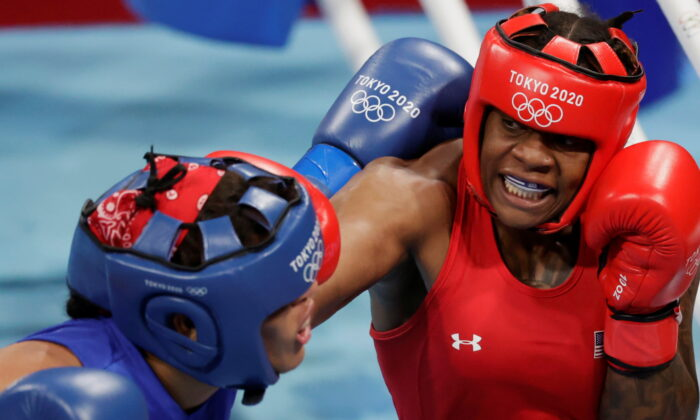 Maria Moronta (L) of the Dominican Republic and Oshae Jones (R) of the United States in action during the Women's Welter (64-69kg) quarterfinal on day seven of the Tokyo 2020 Olympic Games at Kokugikan Arena in Tokyo, Japan, on July 30, 2021. (Ueslei Marcelino/Reuters)