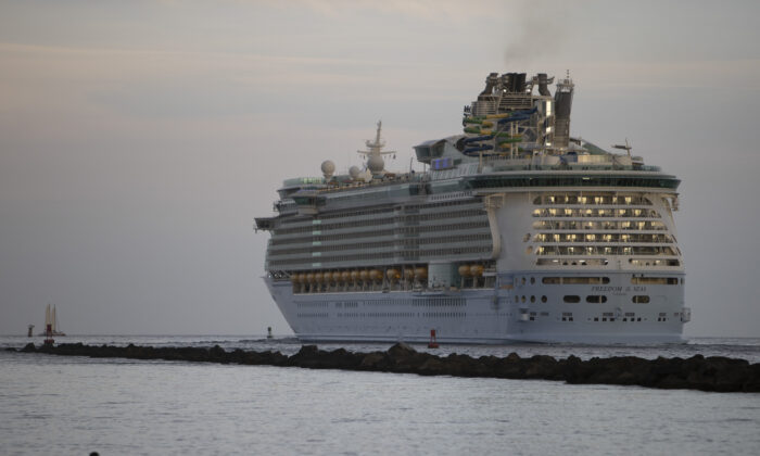 The Royal Caribbean Freedom of the Seas gets underway through the Government Cut shipping channel at Port Miami during the first U.S. trial cruise testing COVID-19 protocols in Miami, Fla., on June 20, 2021. (Joe Raedle/Getty Images)