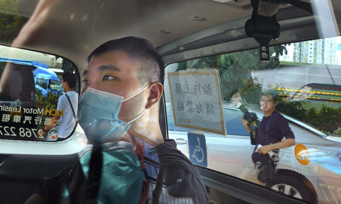 Tong Ying-kit arrives at a court in a police van in Hong Kong, on July 6, 2020. (AP Photo/Vincent Yu,File)