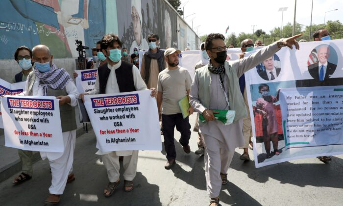 Former Afghan interpreters who worked with U.S. troops in Afghanistan demonstrate in front of the U.S. embassy in Kabul, on June 25, 2021. (Stringer/File Photo/Reuters)