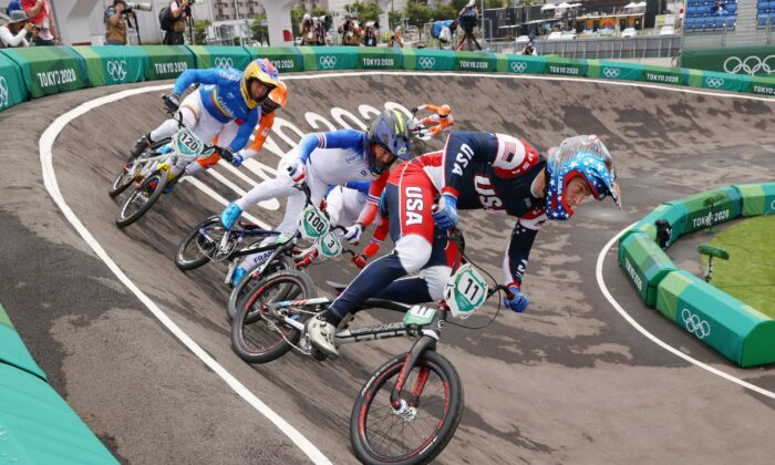 (L-R) Vincent Pelluard of Team Colombia, Romain Mahieu of Team France, Sylvain Andre of Team France and Connor Fields of Team United States as they compete during the Men's BMX semifinal heat 1, run 2 on day seven of the Tokyo 2020 Olympic Games at Ariake Urban Sports Park in Tokyo, Japan on July 30, 2021. (Francois Nel/Getty Images)