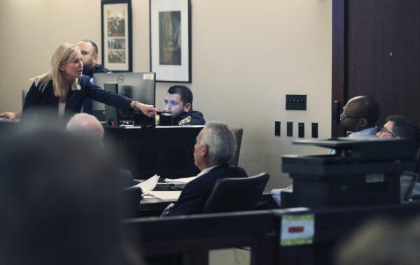 Prosecutor Tamara Strauch points to defendant Otis McKane