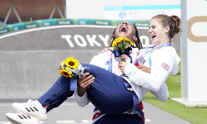 Great Britain's Beth Shriever and Kye Whyte celebrate their gold and silver BMX medals at Tokyo 2020 Olympic Games, Tokyo, Japan, on July 30 2021. (Danny Lawson/PA)