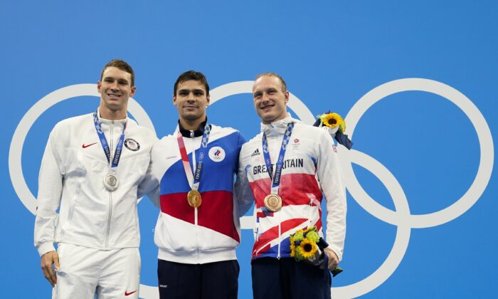 From left, Ryan Murphy, of United States, Evgeny Rylov, of Russian Olympic Committee, and Luke Greenbank, of Britain, pose with their medals after the men's 200-meter backstroke final at the 2020 Summer Olympics in Tokyo, Japan on July 30, 2021. (Gregory Bull/AP Photo)