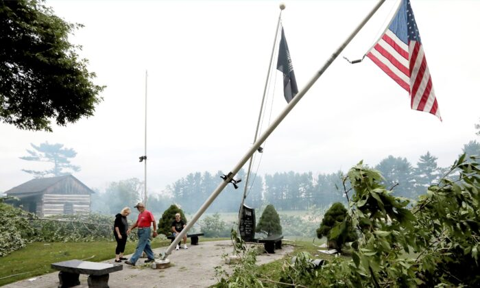 Following an overnight storm, Jefferson County residents inspect damage at Dahnert Park, in Concord, Wis., on July 29, 2021. (John Hart/Wisconsin State Journal via AP)