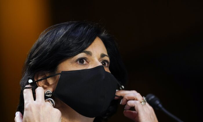 Dr. Rochelle Walensky, director of the Centers for Disease Control and Prevention, adjusts her face mask during a Senate hearing in Washington on March 18, 2021. (Susan Walsh/AP Photo)