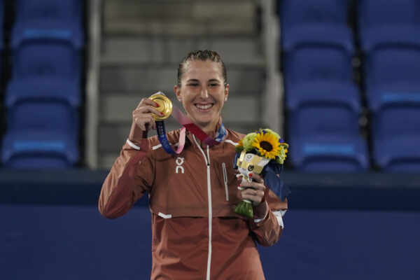 Belinda Bencic, of Switzerland, poses with the gold medal