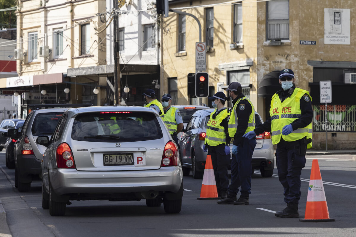 NSW Police check drivers on Enmore Road as part of the enforcement of Public Health orders in Sydney, on July 31, 2021. (Brook Mitchell/Getty Images)