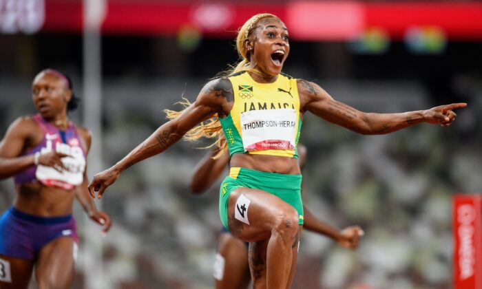 Elaine Thompson-Herah of Team Jamaica celebrates crossing the finish line to win the gold medal in the Women's 100m Final on day eight of the Tokyo 2020 Olympic Games at Olympic Stadium, in Tokyo, Japan, on July 31, 2021. (Matthias Hangst/Getty Images)