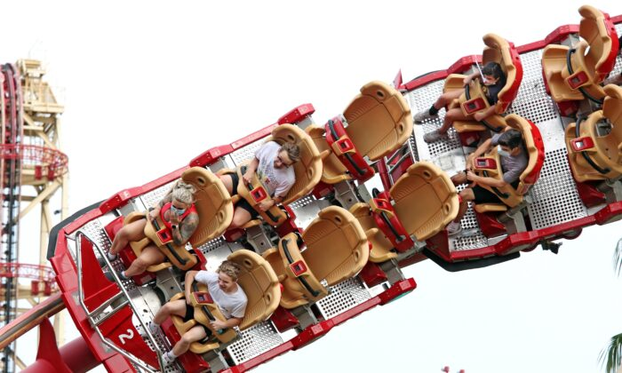 Visitors ride a roller coaster at Universal Studios theme park, in Orlando, Fa., on June 5, 2020. (Gregg Newton/AFP via Getty Images)