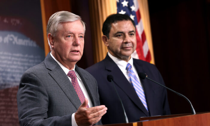 Sen. Lindsey Graham (R-S.C.) (L), joined by Rep. Henry Cuellar (D-Texas), speaks during a news conference at the U.S. Capitol in Washington, on July 30, 2021. (Kevin Dietsch/Getty Images)