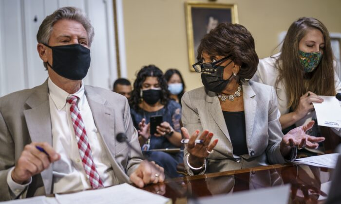 House Financial Services Committee Chairwoman Maxine Waters (D-Calif.), center, gestures while speaking to House Energy and Commerce Chairman Frank Pallone (D-N.J.) as they prepare an emergency extension of the eviction moratorium, at the U.S. Capitol in Washington on July 30, 2021. (J. Scott Applewhite/AP Photo)