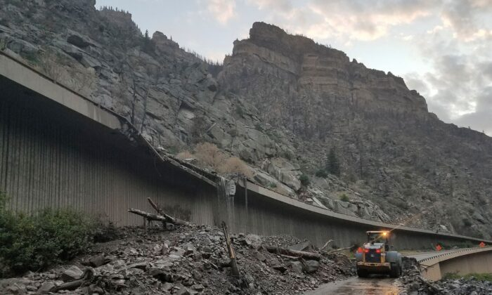 Equipment works to clear mud and debris from a mudslide on Interstate-70 through Glenwood Canyon, Colo., on July 30, 2021. (Colorado Department of Transportation via AP)