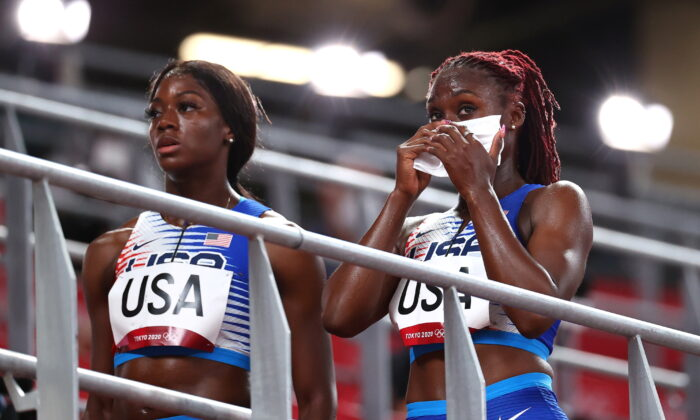 Lynna Irby and Taylor Manson of the United States react after competing in the mixed 4x400m relay heats during the Tokyo 2020 Olympic Games at the Olympic Stadium in Tokyo, Japan, on July 30, 2021. (Lucy Nicholson/Reuters)