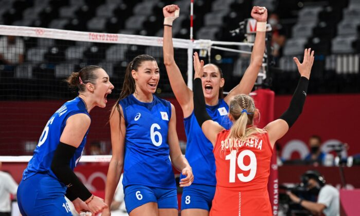 Russia's players celebrate their victory in the women's preliminary round pool B volleyball match between USA and Russia during the Tokyo 2020 Olympic Games at Ariake Arena in Tokyo, Japan, on July 31, 2021. (Jung Yeon-Je/AFP via Getty Images)