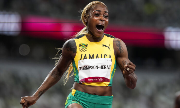 Elaine Thompson-Herah, of Jamaica, wins the women's 100-meter final at the 2020 Summer Olympics in Tokyo, July 31, 2021. (Martin Meissner/AP Photo)