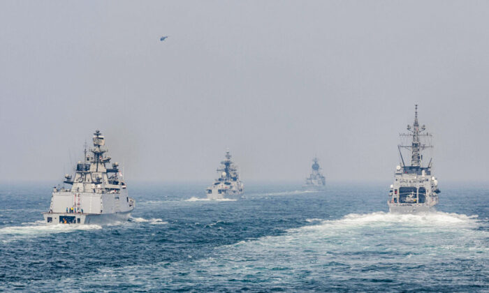 The Arleigh Burke-class guided-missile destroyer USS John S. McCain (DDG 56) sails in formation with ships from the Indian Navy, Royal Australian Navy, and Japan Maritime Self-Defense Force while conducting replenishment-at-seas approaches (RASAPs) as part of Malabar 2020. (U.S. INDOPACOM)