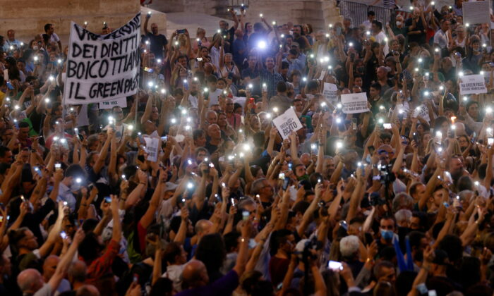 Protesters demonstrate against the Green Pass plan (health pass) in Rome on July 28, 2021. (Guglielmo Mangiapane/Reuters)