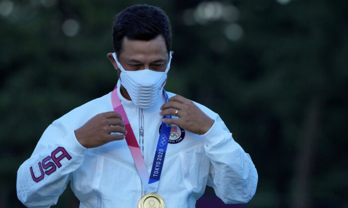 Xander Schauffele of the United States poses with his Gold in the Men's Golf event at the 2020 Summer Olympics, in Kawagoe, Japan, on Aug. 1, 2021. (Andy Wong/AP)