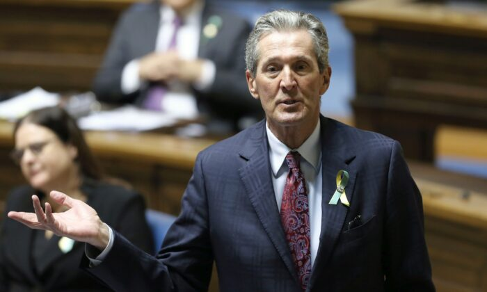 Premier Brian Pallister rises during question period in the Manitoba legislature on April 7, 2021. Pallister was accused of racism for his comments in early July on the toppling of two statues in Winnipeg on Canada Day. (The Canadian Press/Kevin King – POOL)