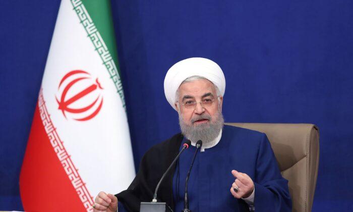 President Hassan Rouhani speaks in the last meeting of his cabinet in Tehran, Iran, on Aug. 1, 2021. (Iranian Presidency Office via AP)