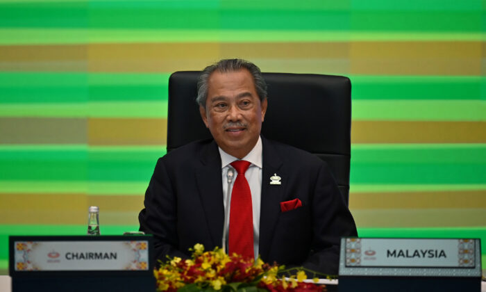 Malaysia's Prime Minister Muhyiddin Yassin takes part in the online Asia-Pacific Economic Cooperation leaders' summit in Kuala Lumpur, Malaysia, on Nov. 20, 2020. (Mohd Rasfan/AFP via Getty Images)