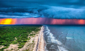 Photographer Snaps Stormy Sublime Sunset—Over Land and Sea—at Carova Beach, NC
