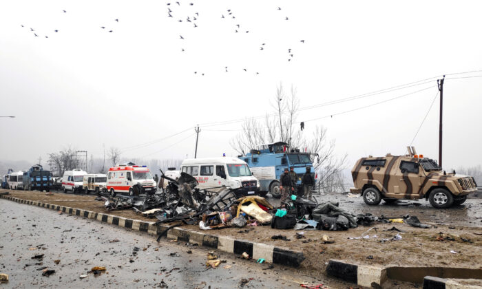 Indian soldiers examine the debris after an explosion in Lethpora in south Kashmir's Pulwama district on Feb. 14, 2019. (Younis Khaliq/File Photo/Reuters)