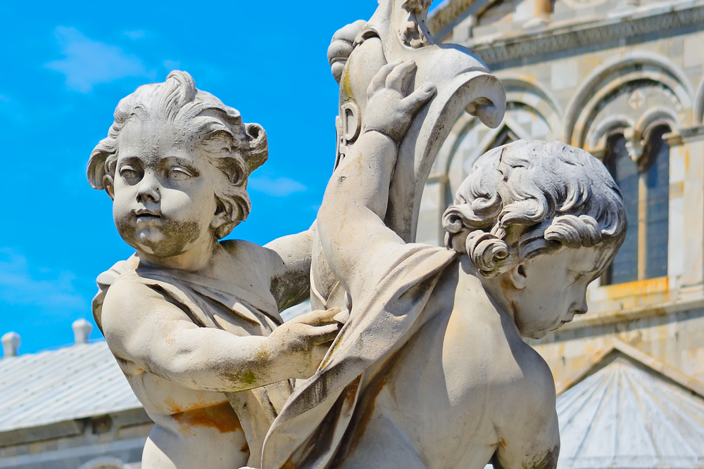 Putti,Fountain,In,Piazza,Dei,Miracoli,In,Pisa,,Italy
