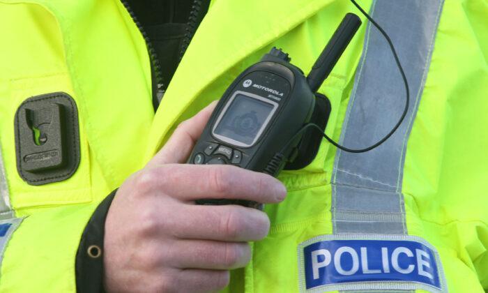 A British police officer using a radio on Nov. 2, 2011. (David Cheskin/PA)