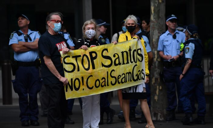 Protesters taking part in a national day of action against mining giant Santos, in Sydney, Australia on December 3, 2020. (AAP Image/Dean Lewins)