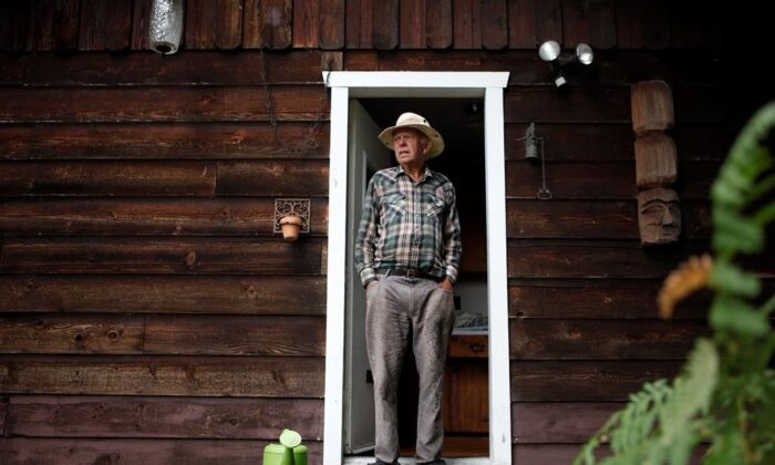 Sahtlam Tree Farm owner Robert Russell in front of his cabin in the Cowichan Valley area of Duncan, B.C., on July 31, 2021. (Chad Hipolito/The Canadian Press)