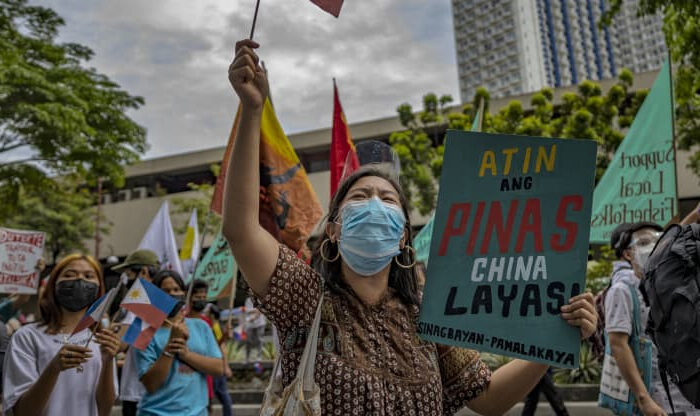Filipinos mark Independence day with a protest against continued Chinese intrusions into Philippine waters, outside the Chinese Embassy on June 12, 2021 in Makati, Metro Manila, Philippines. Local fishermen have expressed disappointment at the government's lackluster stance on China's incursions, and continue to legally fish the West Philippine Sea waters as long as they can. Prior to Duterte's presidency, the Philippines won a landmark case against China in 2016, which invalidated China's claims in the South China Sea within the country's 200-nautical mile exclusive economic zone. (Ezra Acayan/Getty Images)