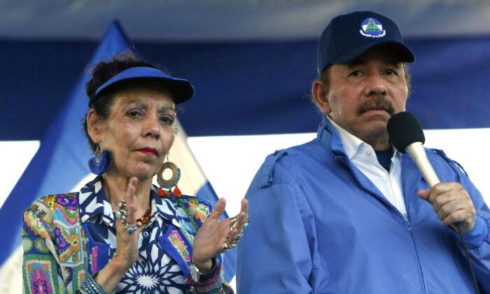 Nicaragua's President Daniel Ortega and his wife, Vice President Rosario Murillo, lead a rally in Managua, Nicaragua, on Sept. 5, 2018. (Alfredo Zuniga/AP Photo)