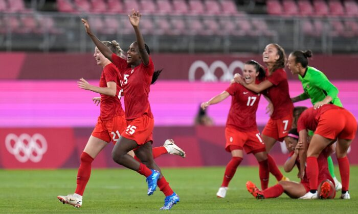 Canada's players celebrate after winning 1-0 to United States during a women's semifinal soccer match at the 2020 Summer Olympics, in Kashima, Japan on Aug. 2, 2021. (Fernando Vergara/AP)