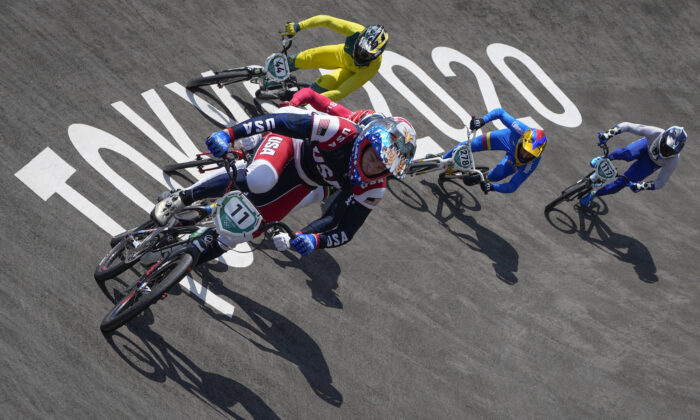 Connor Fields of the United States, (C), leads in the men's BMX Racing quarterfinals at the 2020 Summer Olympics, on July 29, 2021, in Tokyo, Japan. (Ben Curtis/AP Photo)