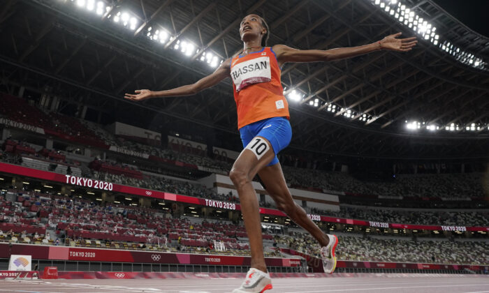 Sifan Hassan of the Netherlands celebrates as she crosses the finish line to win the women's 5,000-meters final at the 2020 Summer Olympics in Tokyo, Japan, on Aug. 2, 2021. (David J. Phillip/AP Photo)