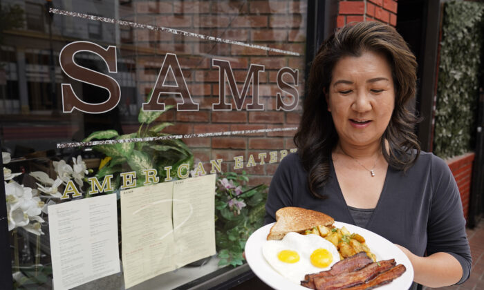 Jeannie Kim holds her popular bacon and eggs breakfast at her restaurant in San Francisco, Calif., on July 30, 2021. (Eric Risberg/AP Photo)