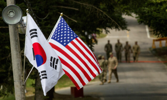 The South Korean and American flags fly next to each other at Yongin, South Korea, on Aug. 23, 2016.  (Courtesy of Ken Scar/U.S. Army/Handout via Reuters)